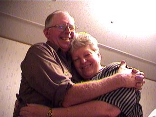 dad and mom hugging in the office